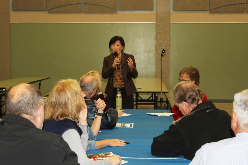 Water district Director Nai Hsueh speaks to residents about the project.